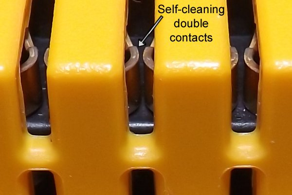 self cleaning double contacts of a cordless power tool battery.