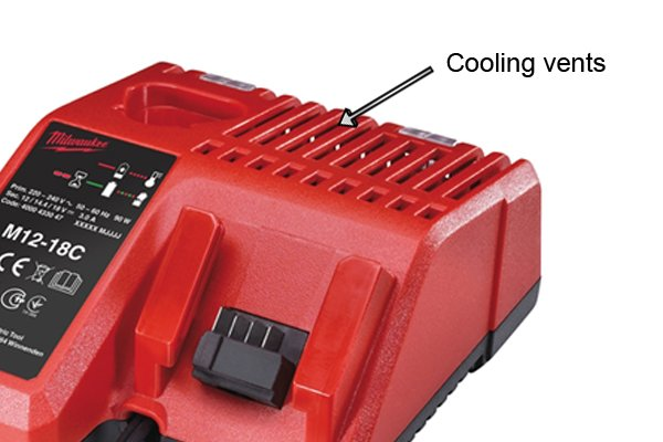 Cooling vents of a charger need to be cleaned to keep them free of dust so the charger can charge the cordless power tool battery properly.