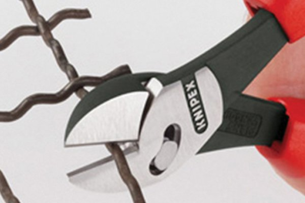 Thick jaws of diagonal side cutting pliers, cutters, nippers put force on wire to cut it.