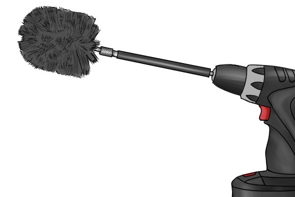 Power drill with pipe cleaning brush attachment aka tube brush, twisted brush, cylinder brush