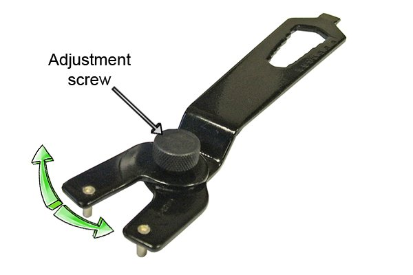Pin spanner with adjustment screw which changes the size of the spanner.