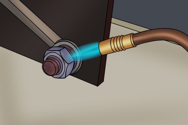 Blow torch used to heat bolt which causes it to expand and contract so it is easier to turn with a spanner