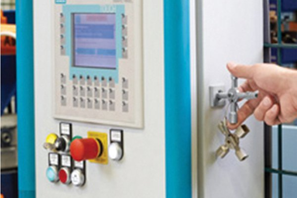 Utility and control or service cabinet key unlocking an electronics cabinet to access a control panel.