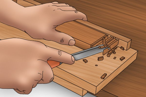 Chiselling wood on a bench hook