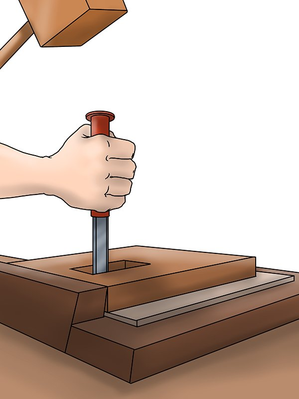 Chiselling out a mortise