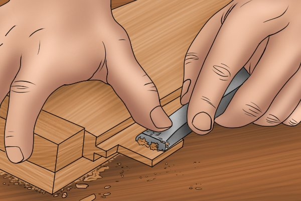 Using a chisel on workpiece held in a bench hook