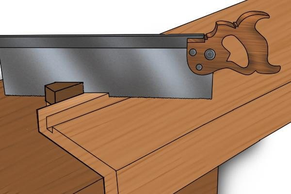 Using a bench hook's mitre guide to cut a mitre
