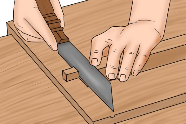 Cutting with tenon saw using bench hook for support