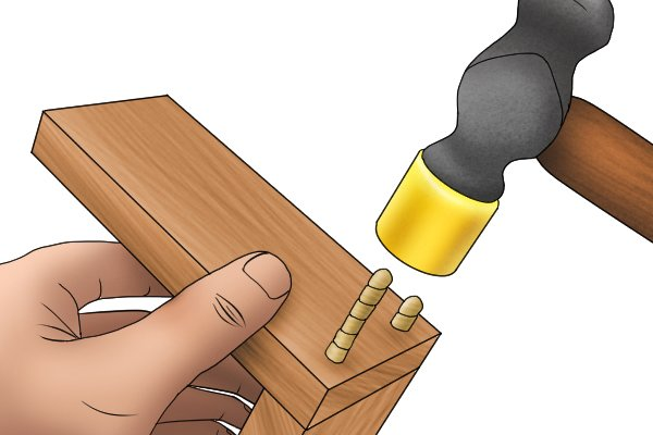 Inserting dowels into wood joint