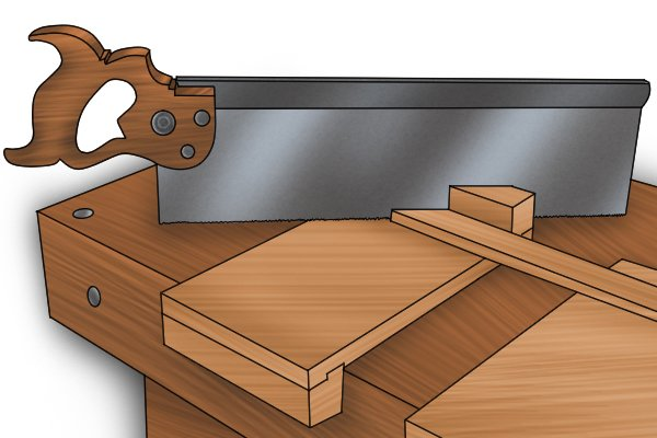 Cutting a mitre with the help of a mitred bench hook