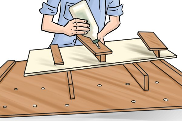 Applying glue to the stop of a bench hook