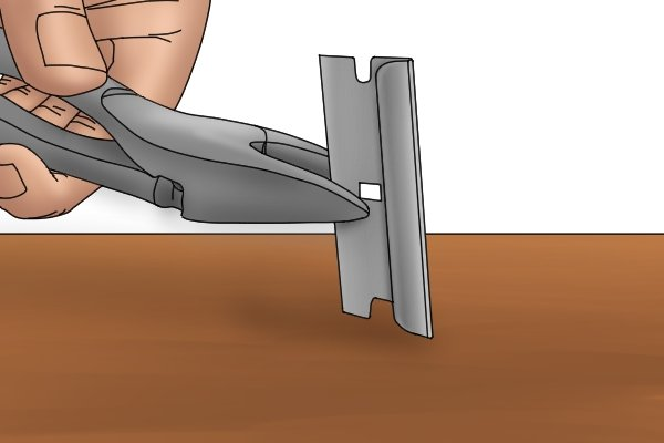 You can use a razor blade to see if a pair of wire cutters will cut a thin wire