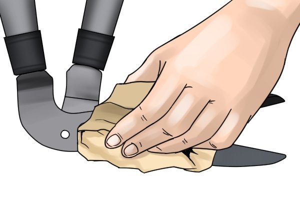 Wiping down edging shear blades with cloth