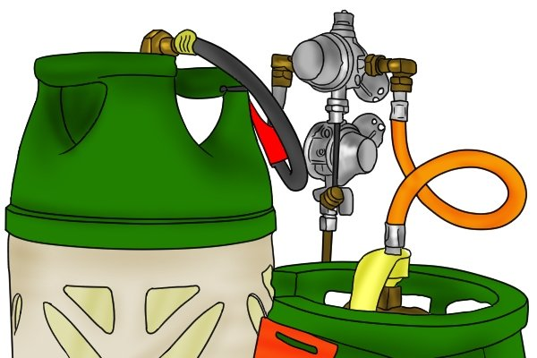 Changeover gas regulator on caravan bulkhead