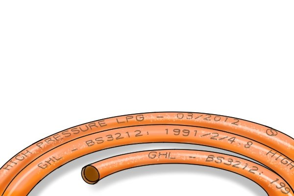 Orange gas hose with date of manufacture stamped on it