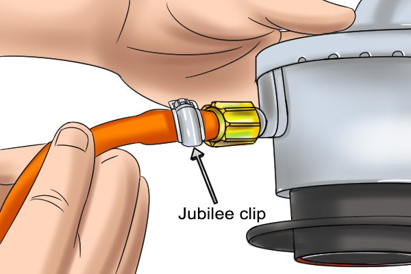 Checking jubilee clip is secure on hose and regulator