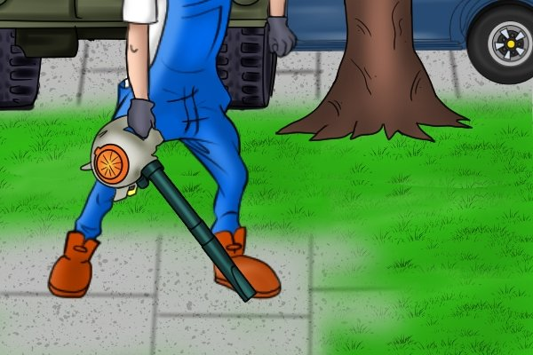Blowing grass clippings off path with leaf blower