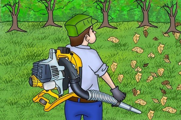 Professional gardener using backpack leaf blower