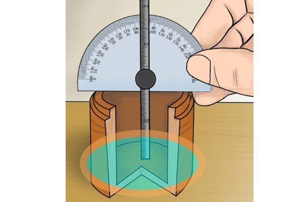 """A protractor and depth gauge in use, showing the rule positioned at the bottom of the """"hole"""" being measured"""