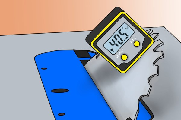 A digital angle gauge with magnets being used to position a saw