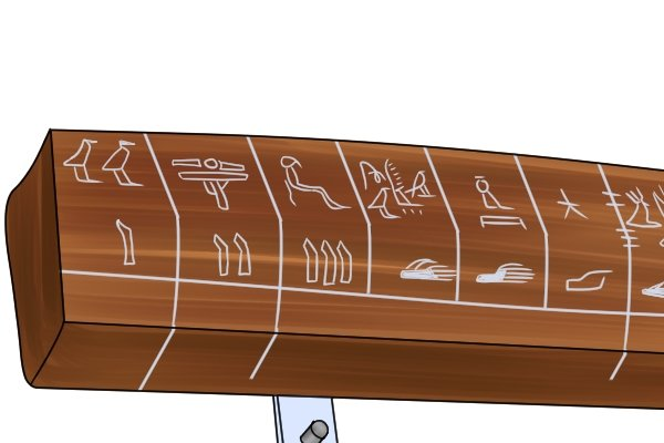 Ancient Egyptian wooden ruler with hieroglyphic graduations along its length