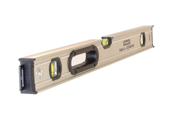 Spirit level placed on top of a straight edge can be used to check the workpiece is level as well as flat