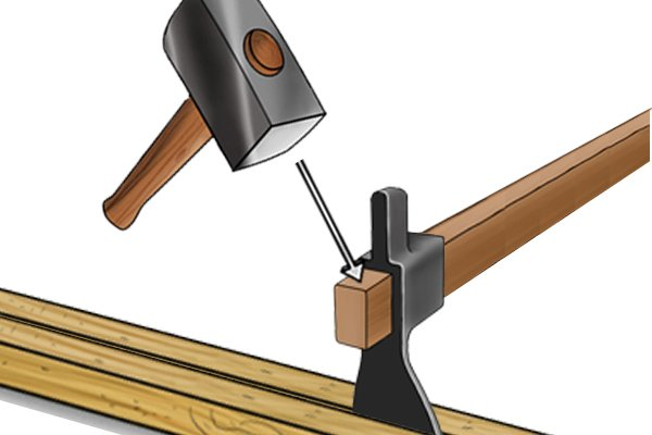 Image of a demolition team hitting an adze head to insert it between two timbers
