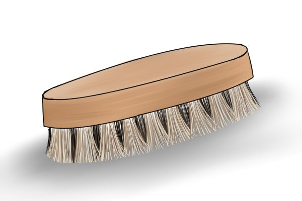 Image of a scrubbing brush, used to clean up an adze handle