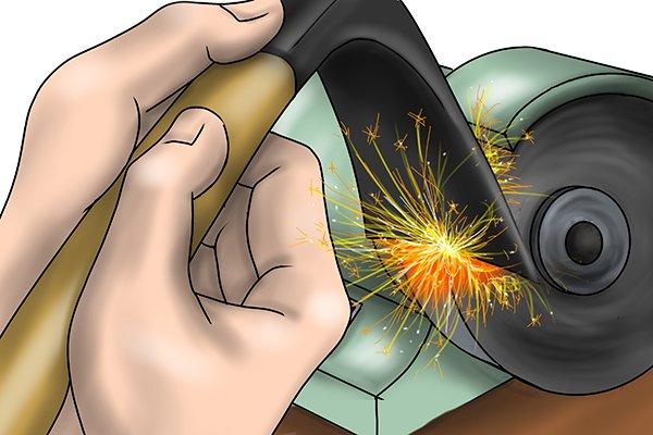 Image of a blacksmith sharpening an adze