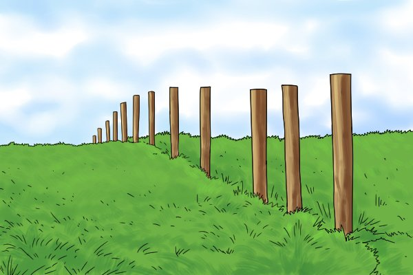 A line of finished fence posts