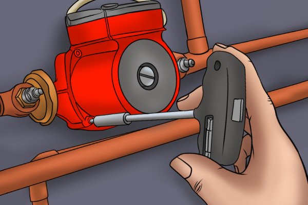 Image showing a DIYer unscrewing the retainer bolts on their circulator pump