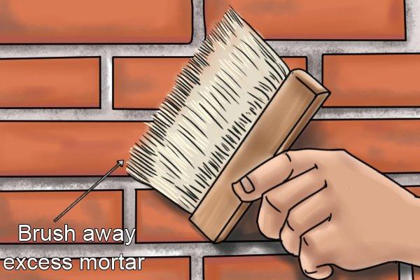 Brush away excess mortar