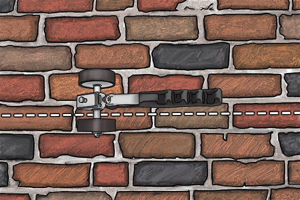 Hold the brick rake handle parallel to the 'perps' and 'beds' of mortar