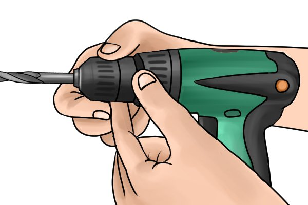 Inserting a drill bit into a cordless drill driver with a spindle lock