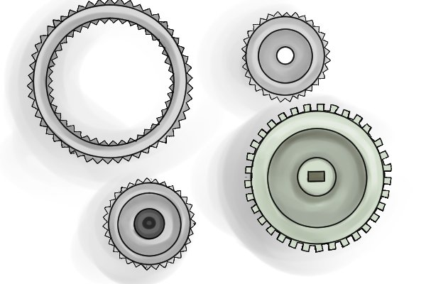 Blue, black and white different sized plastic gears