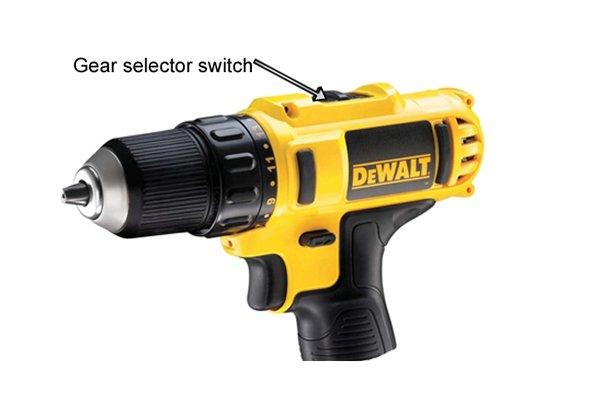 Gear selector switch on a yellow cordless drill driver