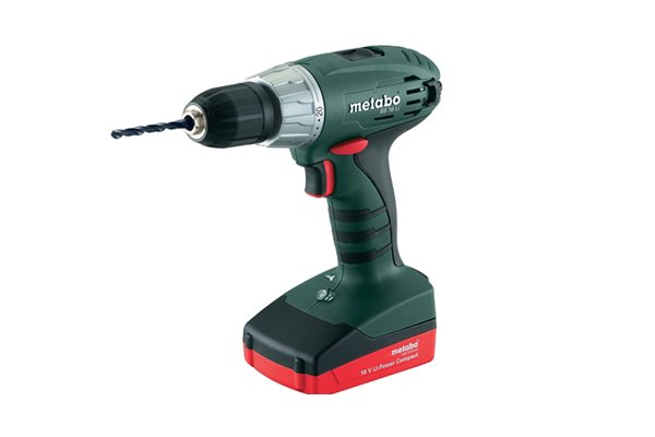 Blue cordless drill driver with an attached drill bit