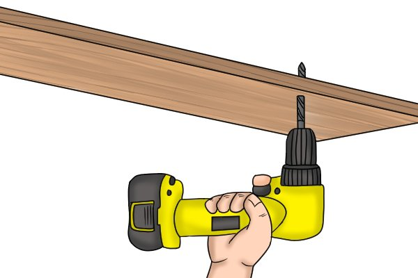 A right angle cordless drill driver being used in a awkward gap