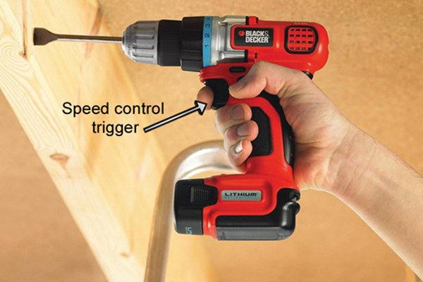 A hand holding the cordless drill driver and being able to reach the speed control trigger comfortably