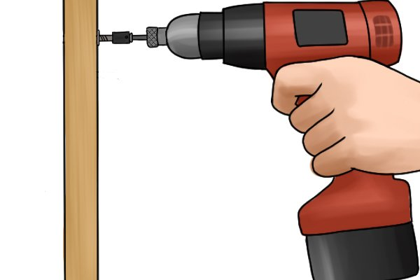 Inserting a screw into a fence with a cordless impact driver