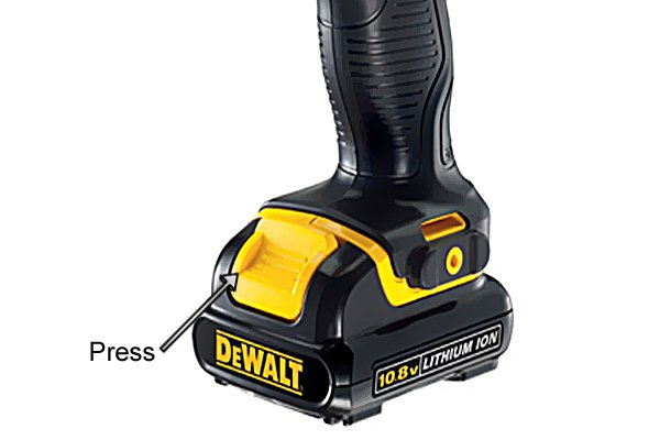 Press battery release button on a cordless impact driver