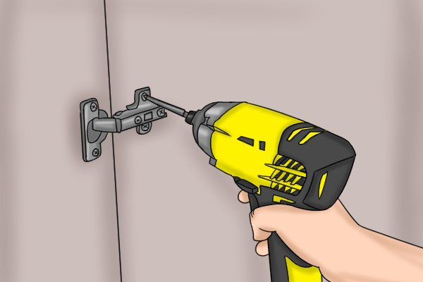 Using a cordless impact driver to drive a screw