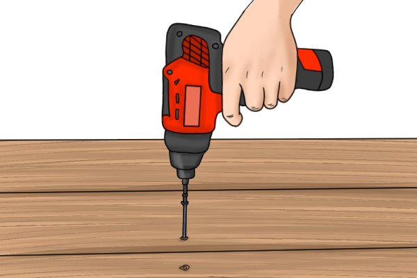 Driving a screw into wood with a cordless impact driver
