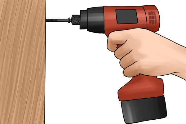 Installing a cabinet with a long screw and a cordless impact driver