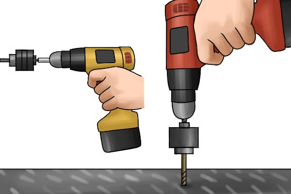 Pressing the speed control trigger on a cordless impact driver