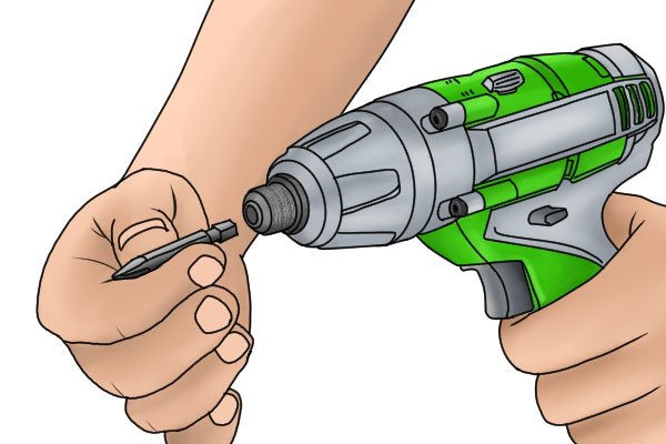 Inserting screwdriver bit into a cordless impact driver