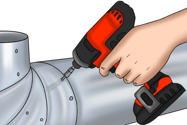 Cordless impact driver working on a metal pipe