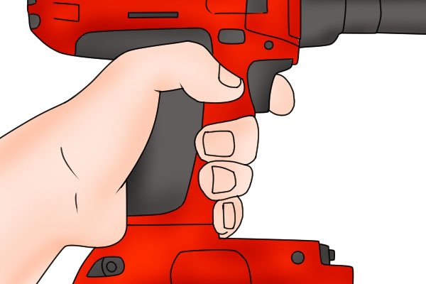 Pulling the speed control trigger on a cordless impact driver