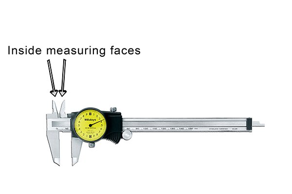 Inside distances, such as the diameter of a hole, are measured using the upper jaws of the dial caliper.
