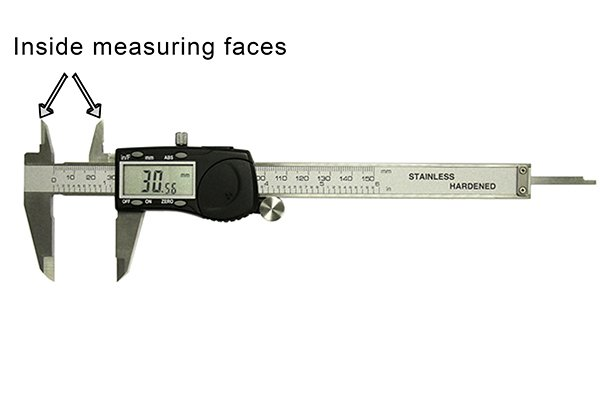 Inside distances, such as the diameter of a hole, are measured using the upper jaws of the caliper.